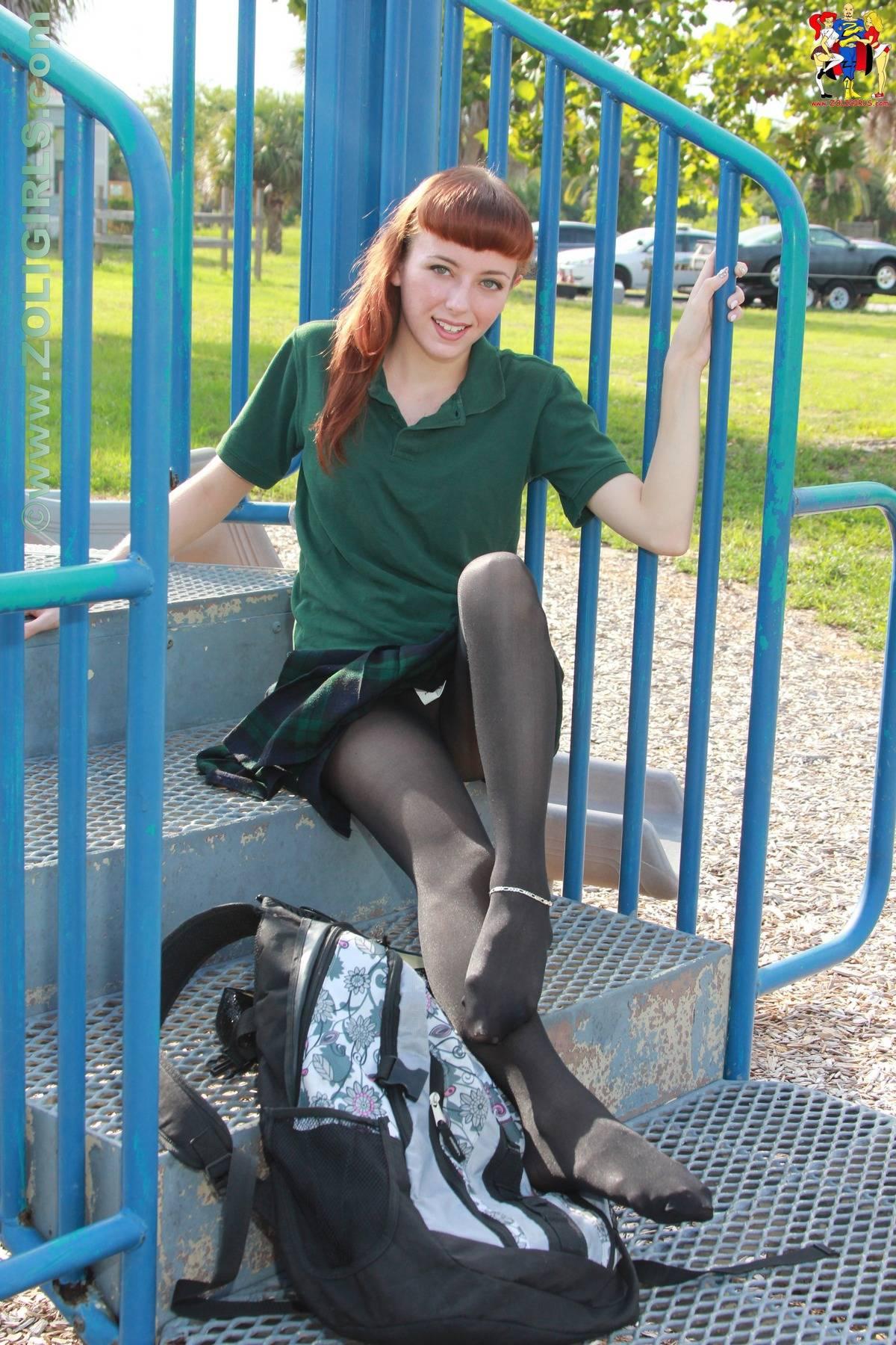 Beautiful teen model Lizzie in her schoolgirl uniform and black opaque ...